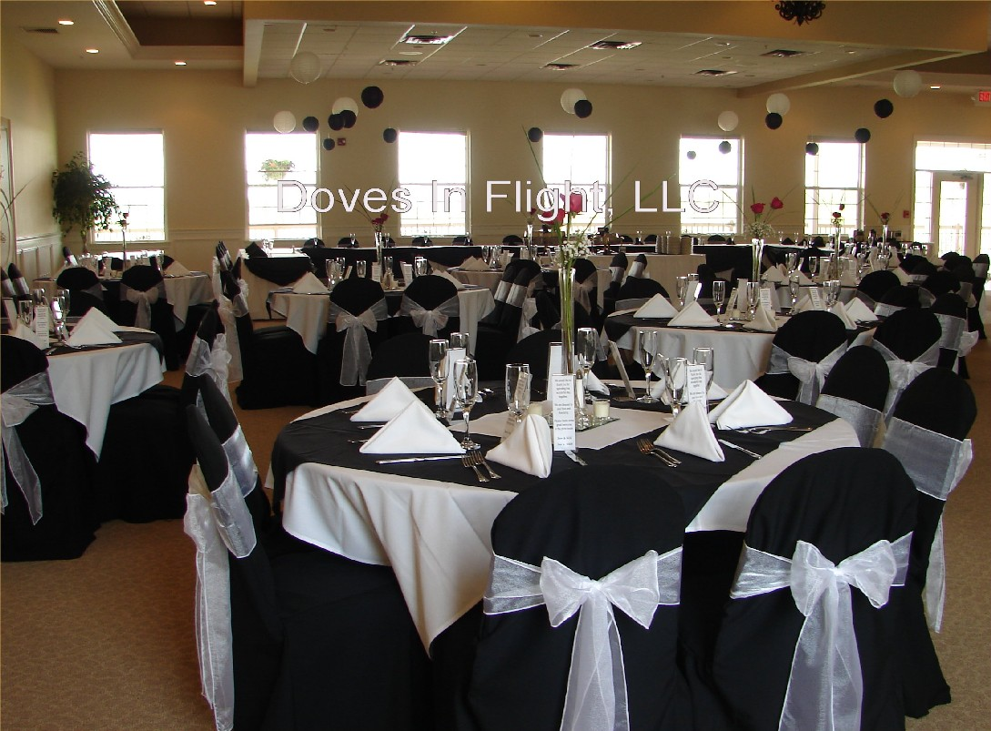 Black chair covers for weddings -  Satin At Crowne Plaza Lansing